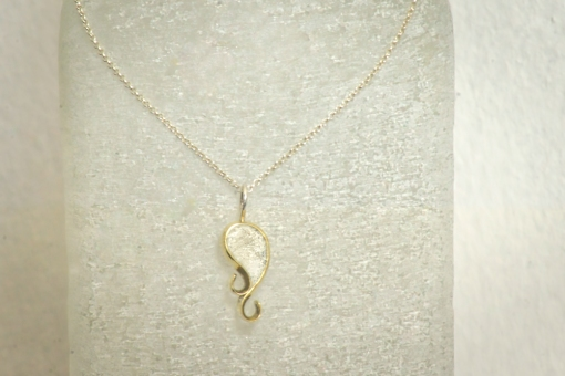 'Wave of the Whale' (crushed rock in brass) including Sterling silver necklace: R 590.00 (approx. EURO 40.00)